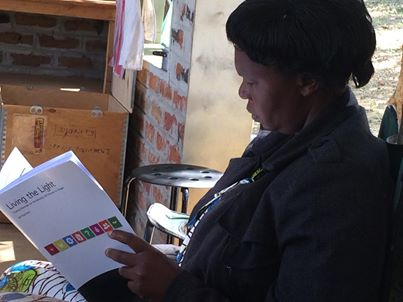 Edna from Mwinlunga looking at Living the Light